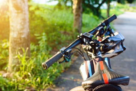road bike: Bike helmet and bike on the street and evening sun