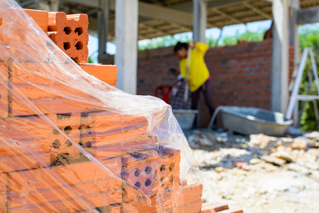 Construction wall Building with brick and cement at daytime