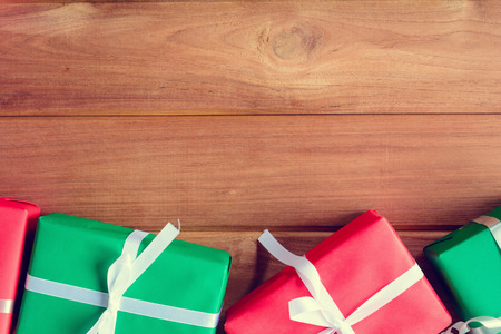 top view christmas gift box on wood table with family holiday