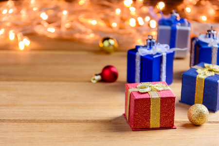 Gift Box Present and decorate on a wooden table with Christmas in the holiday.selective focus