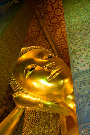 The gold plated reclining Buddha is 46 meters long and 15 meters high, and is designed to illustrate the passing of the Buddha into nirvana. The feet and the eyes are engraved with mother-of-pearl decoration, and the feet also show the 108 auspicious char photo
