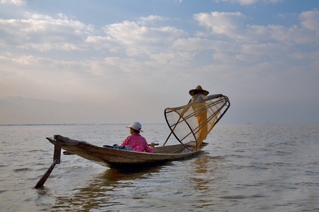 inle:  INLE LAKE, myanmar-FEB 23, 2011,  :Local fishermen are known for practicing a distinctive rowing style Editorial