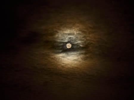 Full moon close-up and clouds against a black night sky Stock Photo - 9453658