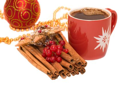 Christmas tree bauble ornament,  star decoration, cinnamon and cup of coffe isolated on white background photo