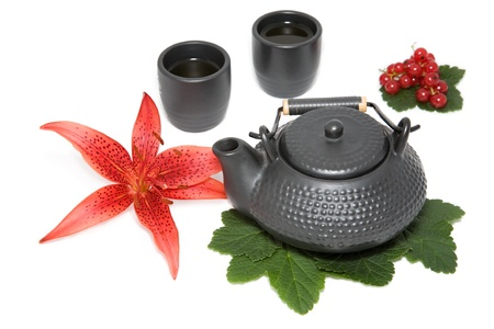 teapot and two cup with flower of  red lily and  wineberry