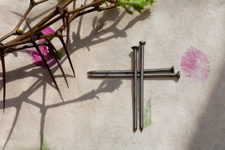Crown of Thorns and crucifix on   paper background photo