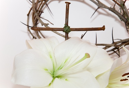 Crown of Thorns, crucifix and Easter white Lily  on  white background photo