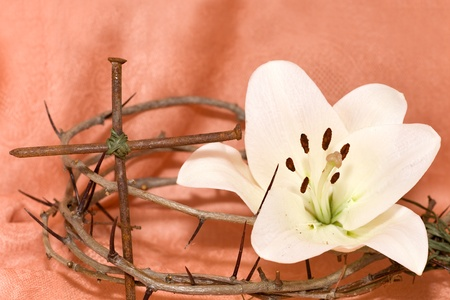 good friday: Crown of Thorns, crucifix and Easter white Lily on  Beige background