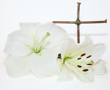 metal  crucifix and Easter white Lily  on  white background photo
