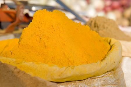 Turmeric powder spice pileat market photo