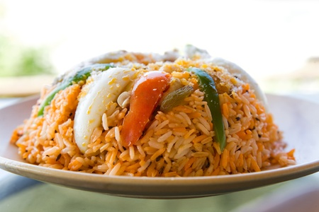fried rice with vegetables, curry and seafood on the  plate  photo