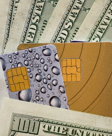 different credit cards  and banknotes of u s  dollar photo