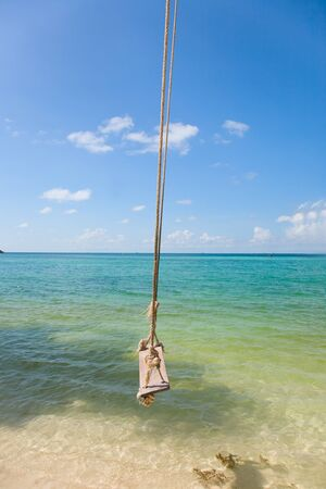 View of tropical beach with  Old  Swing Tied to anTree in Koh Panangan Stock Photo - 12975312