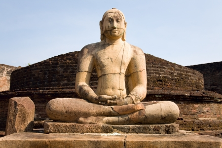 Ancient Buddha statue with blue sky on background  at Vatadage temple in Pollonnaruwa, Sri Lanka  photo