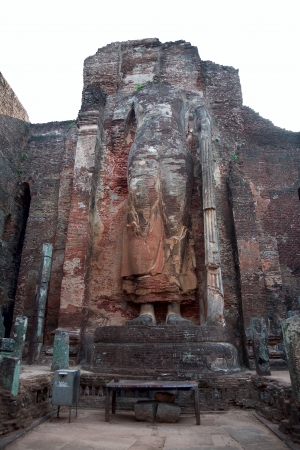 The ruined standing Buddha statue with app. 8m height, Polonnaruwa (ancient Sri Lankas capital), Sri Lanka photo