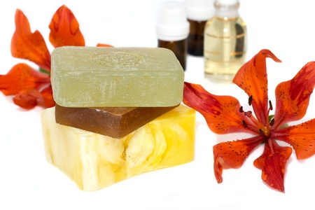 soap with natural ingredients , flowers an bottles of aromatic oil  Stock Photo