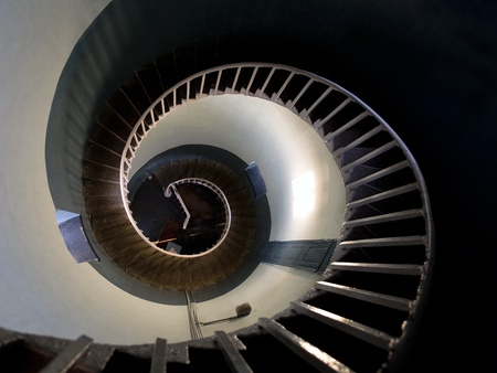 Upside view into the spiral of a lighthouse in Mamalipuram, India photo