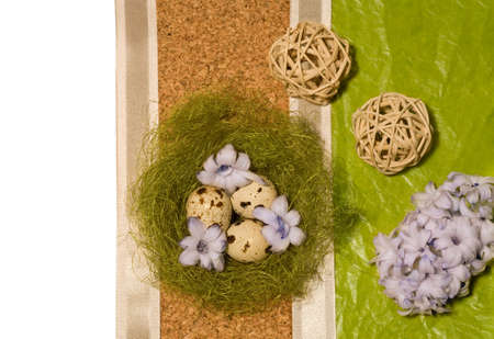 eastertime: Easter eggs  in nest, blue hyacinth and wooden ball