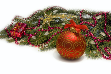 Christmas Decoration: Christmas red ball, twig of fir , red beads.Holiday Decorations Isolated on White  photo