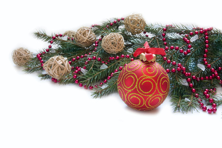 Christmas Decoration Christmas red ball, twig of fir and beads Holiday Decorations Isolated on White  photo