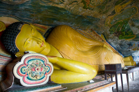 tangalle: reclining buddha in Cave temple in Milkirigala near Tangalle, Sri Lanka. Cave temple has five caves under a vast overhanging rock and dates back to the first century BC