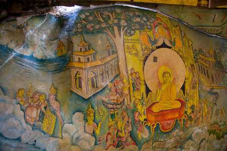 tangalle: painted on stone with buddha  in Cave temple in Milkirigala near Tangalle, Sri Lanka. Cave temple has five caves under a vast overhanging rock and dates back to the first century BC