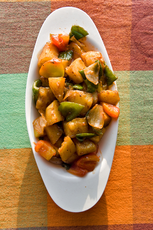 griddle: fried rise and potatoes with vegetables on the  griddle