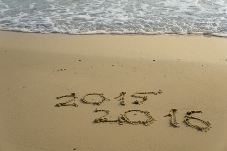 newcomer: new year numbers 2015 and 2016  drawings in the sand on the beach
