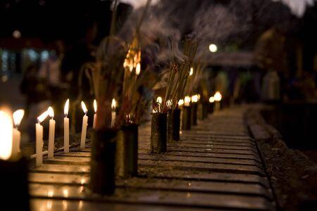 smolder: Burning Incense sticks and candle . Altar at Shwedagon Pagoda, Myanmar Stock Photo