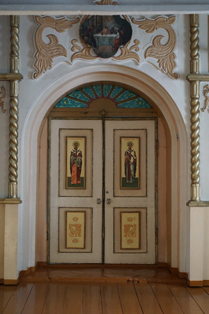 sacred trinity: NIZHNE ABLYAZOVO, RUSSIA - JANUARY 02, 2016:  The door to presbytery with the icons of the four evengelists and the Annunciation scene  in Church of the Nativity of Christ in  NIZHNE ABLYAZOVO,  Penza region Russia. popular landmark.