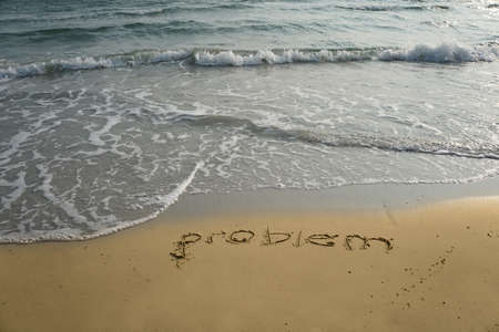 changing form: Handwriting word problem  written  in the sand