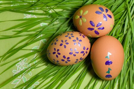 eastertime: Colorful Painted Easter Eggs on green Grass