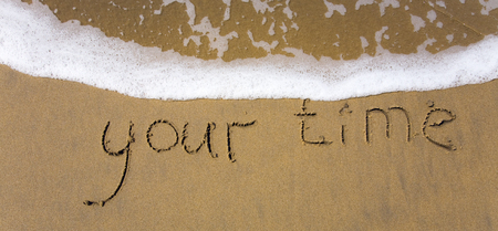 Handwriting word your time written in the sand. Banner