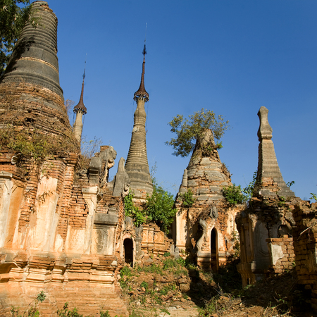 Shwe Inn Thein Paya, Indein, (Nyaungshwe),  Inle Lake,Shan state, myanmar (Burma). Weather-beaten buddhistic zedi constructed in 17th and 18th century damaged by earthquake in 1975, partitialy back reconstructed. Imagens