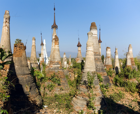 Shwe Inn Thein Paya, Indein, (Nyaungshwe),  Inle Lake,Shan state, myanmar (Burma). Weather-beaten buddhistic zedi constructed in 17th and 18th century damaged by earthquake in 1975, partitialy back reconstructed. Stock fotó