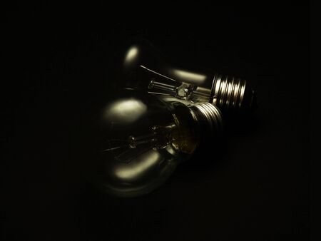 incandescent: Two incandescent lamps on a black background Stock Photo