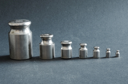 standard steel: Metal weights for scales on a black background Stock Photo