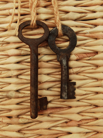 two keys on a background of woven box