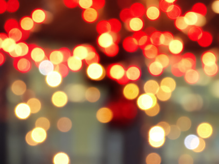 Background of defocused photo in the evening garlands. Red, yellow, orange colors. Photo Stok Fotoğraf