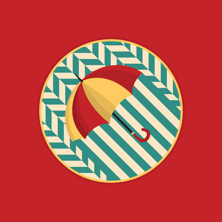 Image of a red yellow umbrella on a blue geometric pattern.