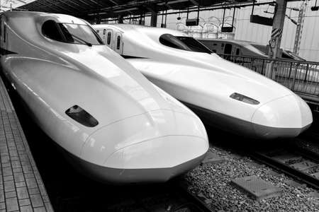 bullet train: TOKYO, JAPAN - AUGUST 20 Bullet train is arriving into Tokyo station  These high speed trains reaching the speeds over 300Km h  They are called Shinkansen