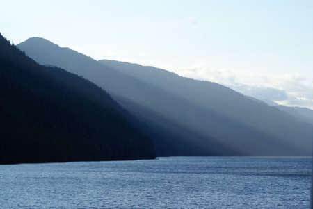 shaddow: Low Alaskain Sun lights these coastal mountains