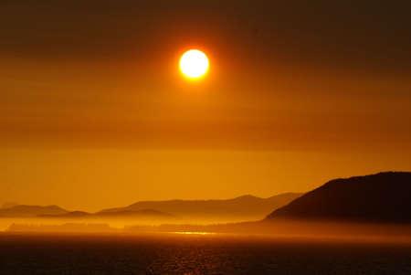 Zons ondergang mist in Alaska