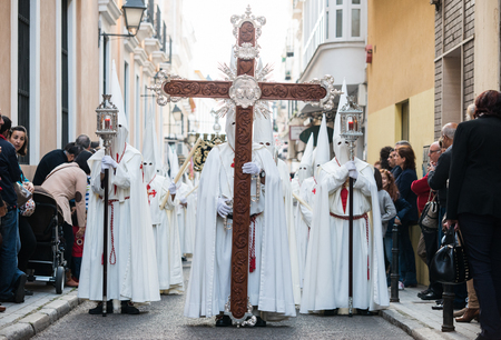penitence: Badajoz, Spain - April 19, 2014: A group of Nazarenes participating in the procession of Holy Week in the city center.