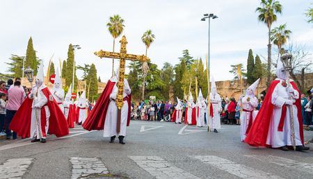 christianity palm sunday: Badajoz, Spain - march 29, 2015:A group of Nazarenes participating in the procession of Palm Sunday
