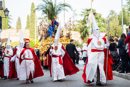 badajoz: Badajoz, Spain - march 29, 2015:A group of Nazarenes participating in the procession of Palm Sunday