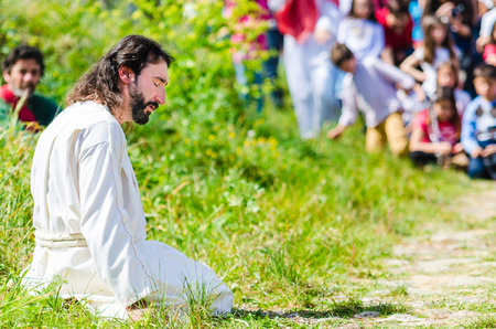 the believer: Alburquerque, Spain - april 03, 2015: A group of actors depicting the crucifixion of Christ in Alburquerque on Holy Friday Editorial