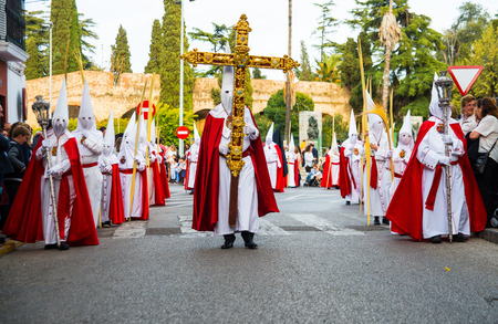 penitence: Badajoz, Spain - march 29, 2015:A group of Nazarenes participating in the procession of Palm Sunday