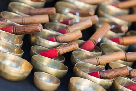 tibetan singing bowl: Tibetan singing bowls of various sizes in a market Stock Photo