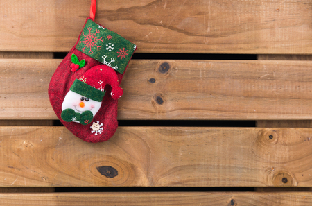 christmas sock: Christmas sock with Snowman on wooden background